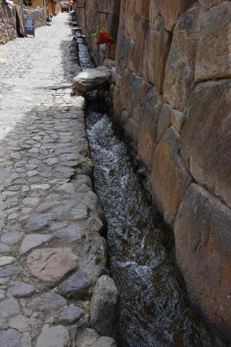 Inca aqueduct running through Pisac